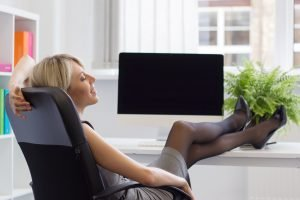 Relaxed woman enjoying a micro break to build resilience, increase productivity and manage change